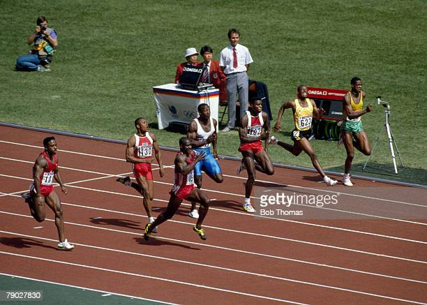 Canadian track athlete Ben Johnson pictured in first place to win the gold medal in the final of the Men's 100 metres event with Carl Lewis of the...