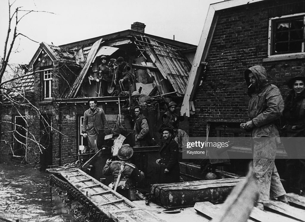 Canadian troops stranded in Nijmegen by flooding during World War II 1945 The flooding was caused by the bombing of the dykes