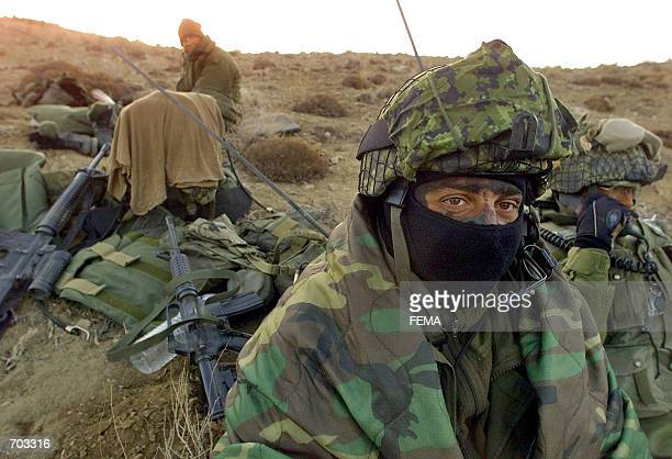 Canadian Warren Officer Eric Gebhardt from Fort Saskatchewan Alberta wears his combat face paint and a face mask March 14 2002 in the Shahi Kot...