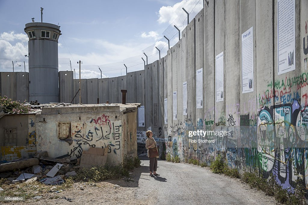 Canadian writer Linda Spalding looks at the Israeli West Bank barrier during the 2014 Palestine Festival of Literature on June 2 2014 in Bethlehem...