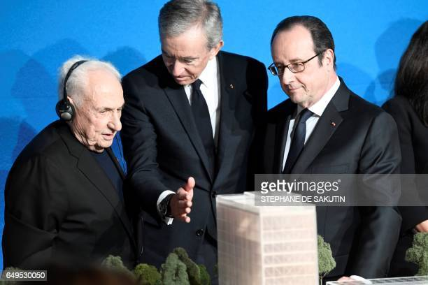 CanadianAmerican architect Frank Gehry CEO of LVMH Bernard Arnault and French president Francois Hollande look at a scale model during a press...