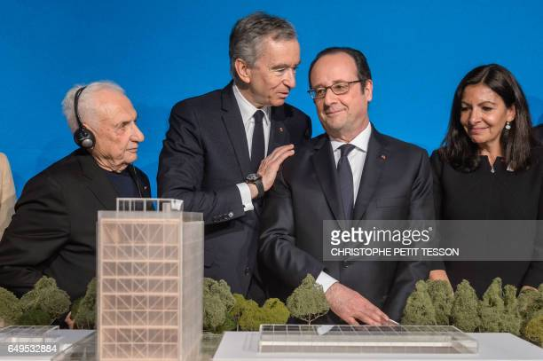 CanadianAmerican architect Frank Gehry CEO of LVMH Bernard Arnault French president Francois Hollande Paris' mayor Anne Hidalgo look at a scale model...