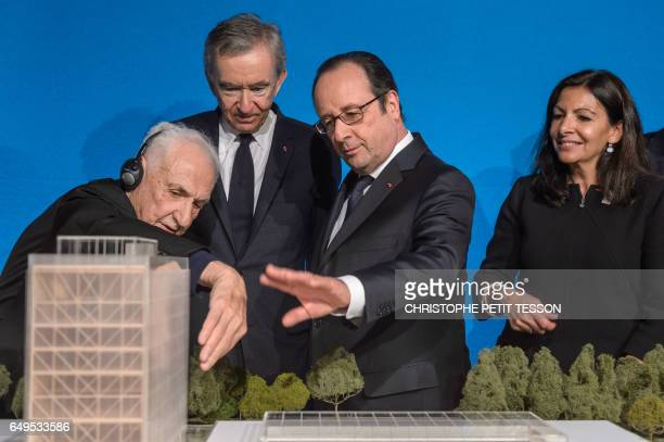 CanadianAmerican architect Frank Gehry CEO of LVMH Bernard Arnault French president Francois Hollande and Paris' mayor Anne Hidalgo look at a scale...