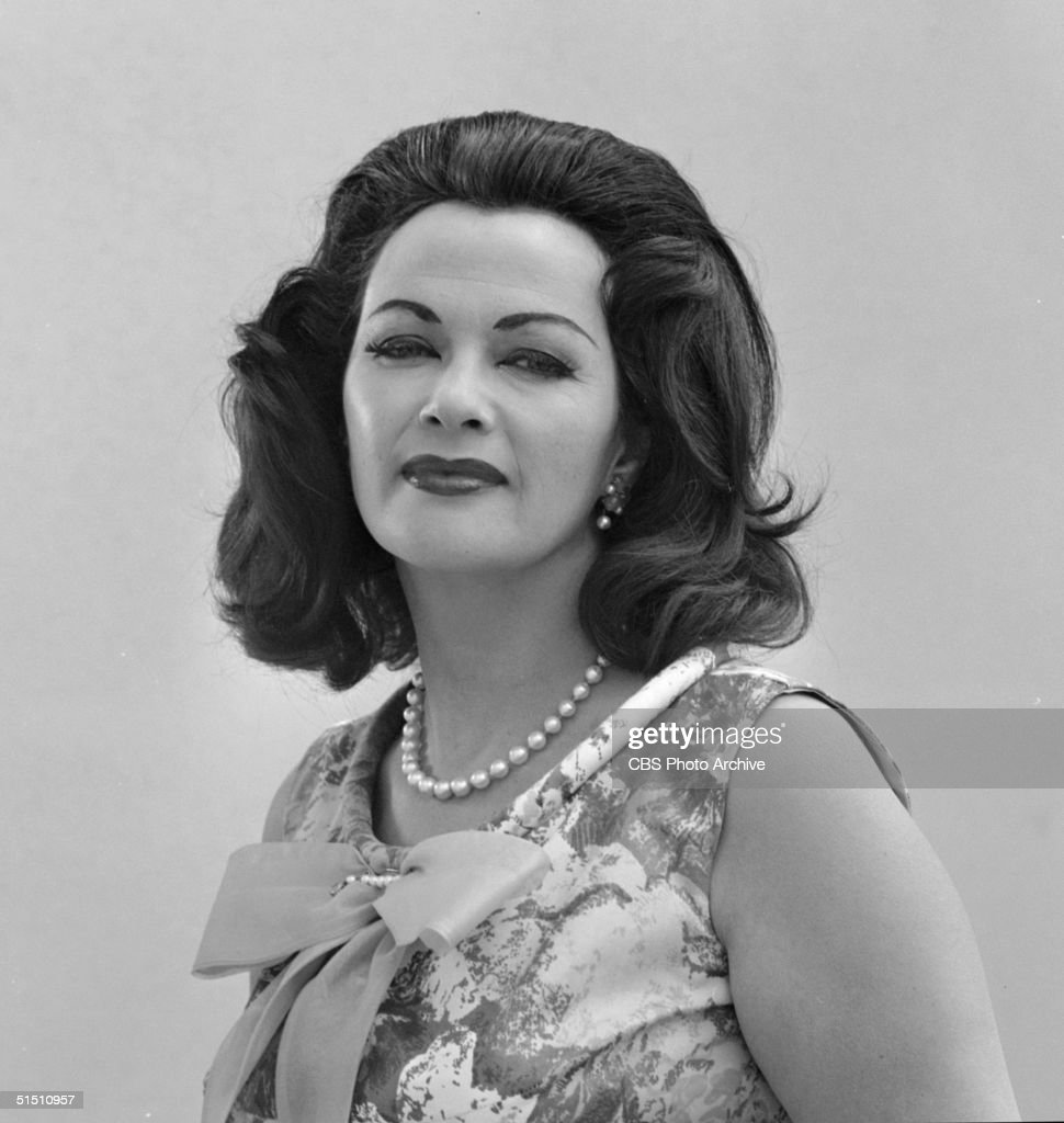 Canadian-born actress Yvonne de Carlo poses for this portrait in a dress with a bow and a pearl necklace to promote the CBS television situation comedy 'The Munsters' in which she plays 'Lily Munster' matriarch of a family of monsters, April 30, 1965.
