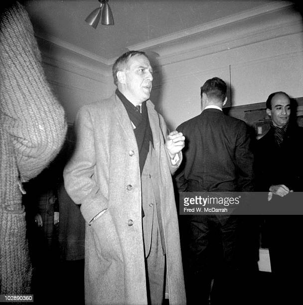 Canadianborn American abstract expressionist painter Philip Guston stands in the Tibor de Nagy Gallery during a show New York New York November 25...