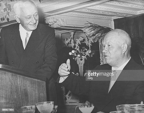 Canadianborn American financier Cyrus S Eaton at lunch with Nikita Khrushchev at the Biltmore Hotel New York 30th September 1960 Demonstrators...