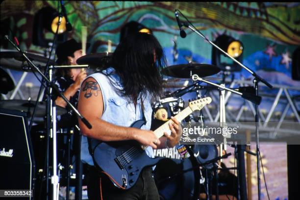 Canadianborn American musician Chan Kinchla of the group Blues Traveler plays guitar as he performs onstage at the Woodstock '94 festival Saugerties...