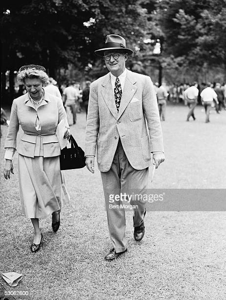 Canadianborn beautician and cosmetics entrepreneur Elizabeth Arden and American racehorse owner and breeder Leslie Combs II walk on the grounds at...