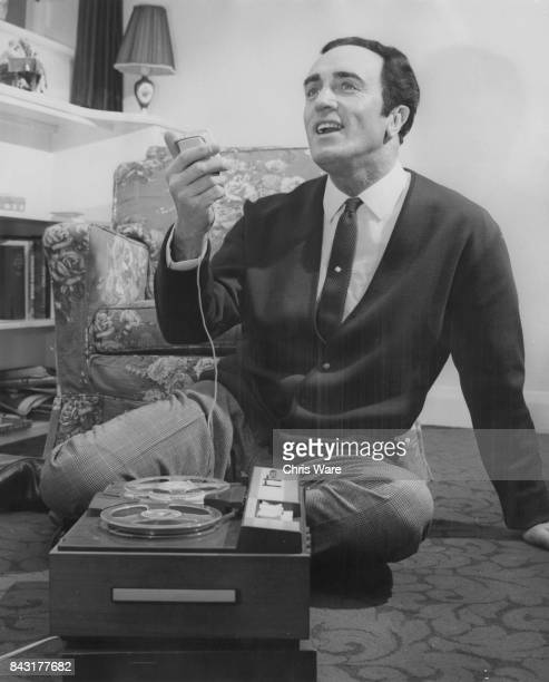 Canadianborn British singer John Hanson tapes his own voice at his home in WaltononThames UK February 1968 He is starring in 'The Desert Song' at the...