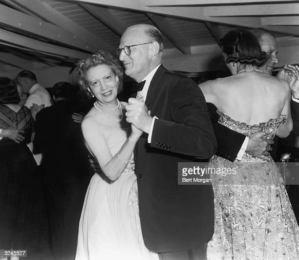 Canadianborn cosmetics executive Elizabeth Arden dances with Leslie Combs II on a dance floor Saratoga New York