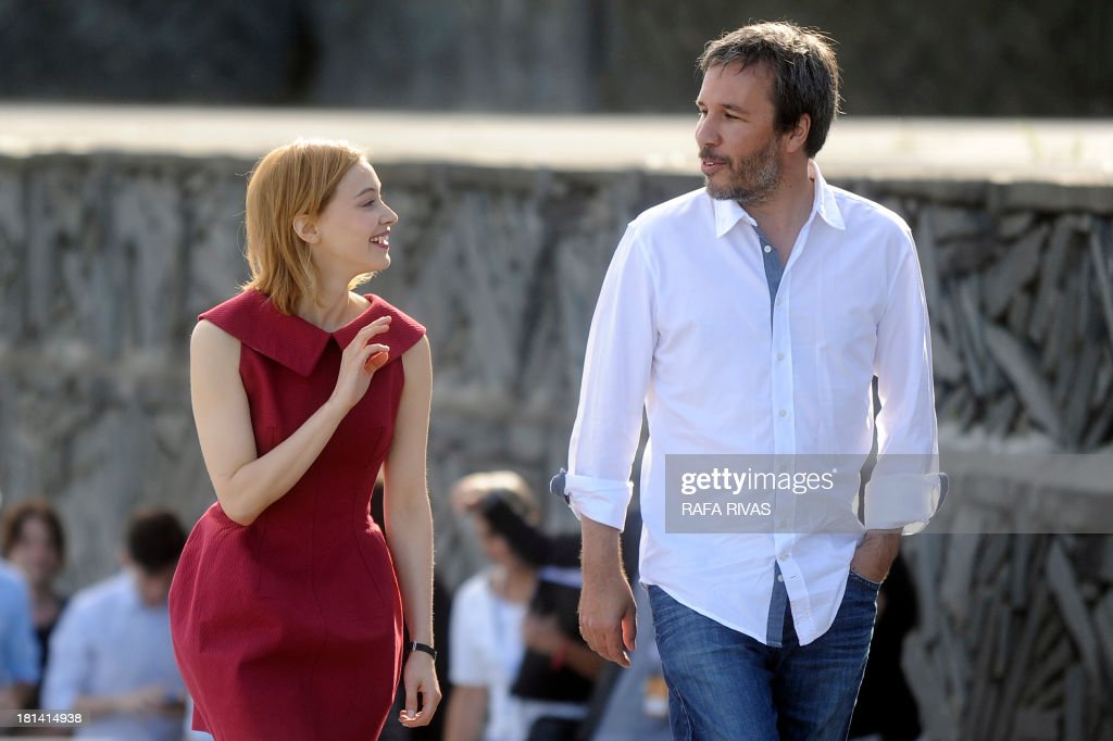 Canadians, actress Sarah Gadon (L) and director Denis Villeneuve (R) chat at a photocall after the screening of their film 'Enemy' during the 61st San Sebastian International Film Festival in the northern Spanish Basque city of San Sebastian on September 21, 2013. AFP PHOTO/ RAFA RIVAS