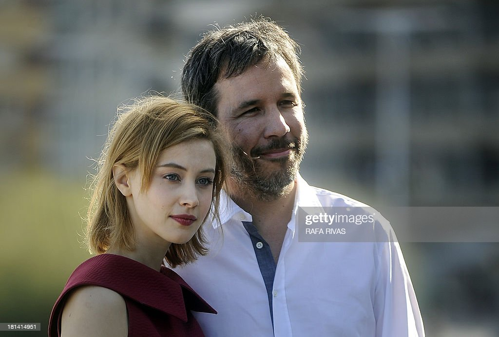 Canadians, actress Sarah Gadon (L) and director Denis Villeneuve (R) pose at a photocall after the screening of their film 'Enemy' during the 61st San Sebastian International Film Festival in the northern Spanish Basque city of San Sebastian on September 21, 2013.