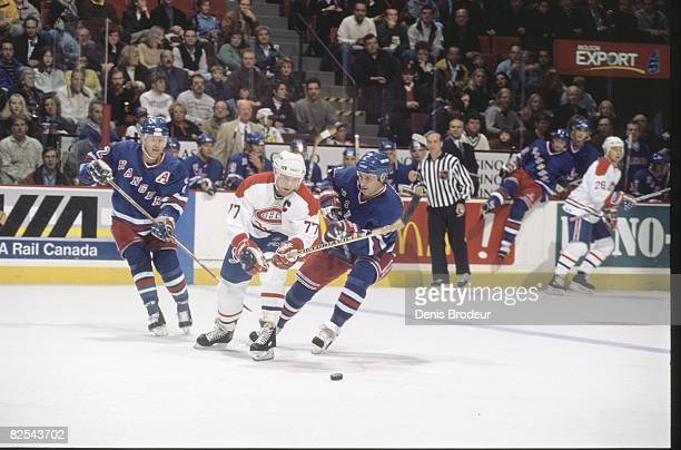 Canadiens captain Pierre Turgeon fights for the puck against Rangers defencemen Brian leetch and Jeff Beukeboom in a game at the Molson Centre during...