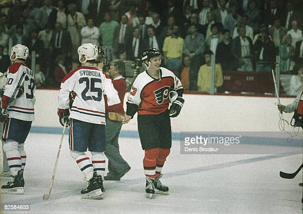 Canadiens defenceman Petr Svoboda shakes hands with Flyers Forward Ilkka Sinisalo after Philadelphia victory in Wales Conference finals at the...
