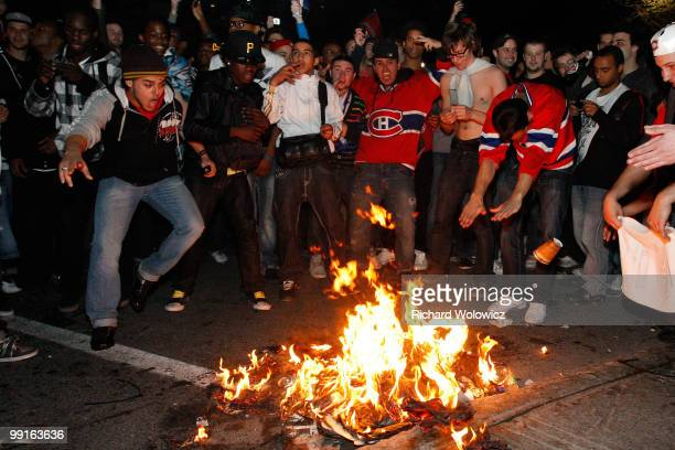 Canadiens fans celebrate the Montreal Canadiens defeat of the Pittsburgh Penguins in Game Seven of the Eastern Conference Semifinals during the 2010...