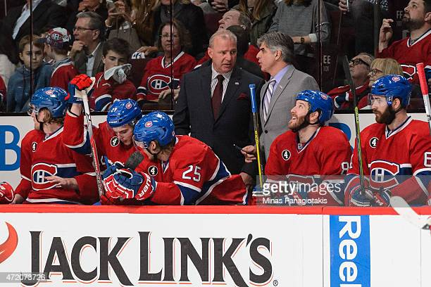 Canadiens' head coach Michel Therrien speaks with assistant coach JeanJacques Daigneault in Game One of the Eastern Conference Semifinals against the...