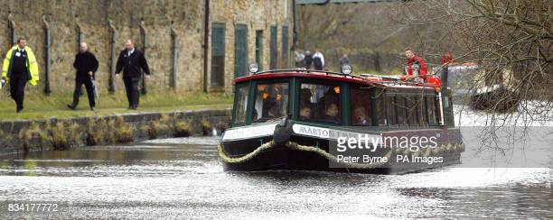 A canal boat which is carrying the Prince of Wales makes its way down the Leeds Liverpool Canal in Burnley