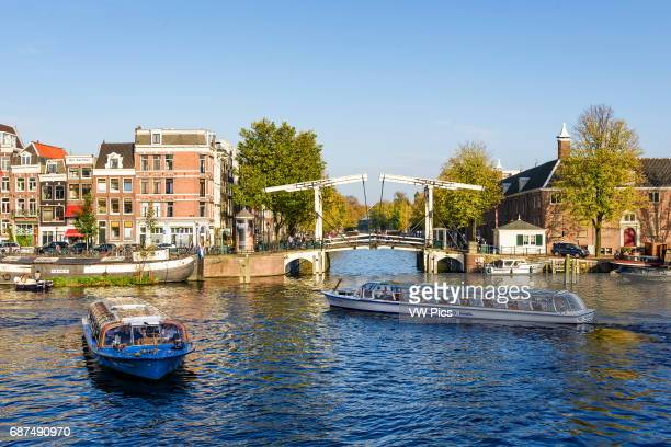 Canal boats at the Amtel in Amsterdam the Netherlands