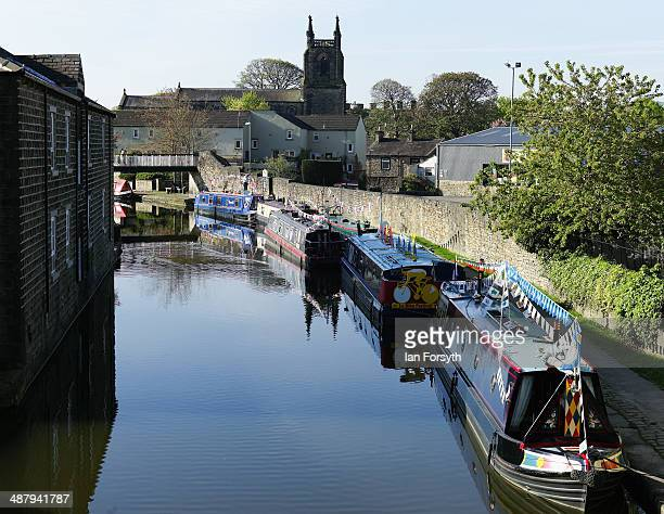 Canal boats themed to celebrate the Tour de France stages which are to be held in Yorkshire later in the year are moored up as they take part in the...