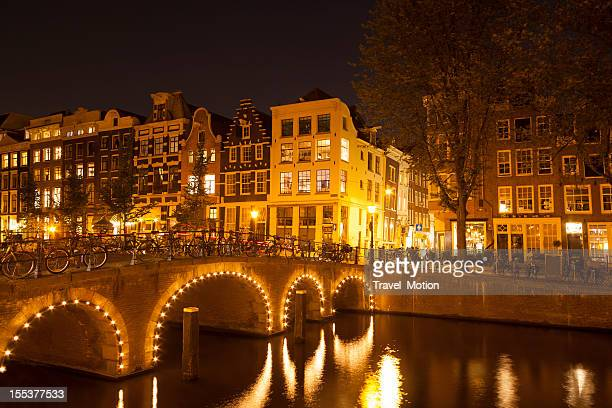 Canal bridge illuminated at night, Amsterdam, Netherlands