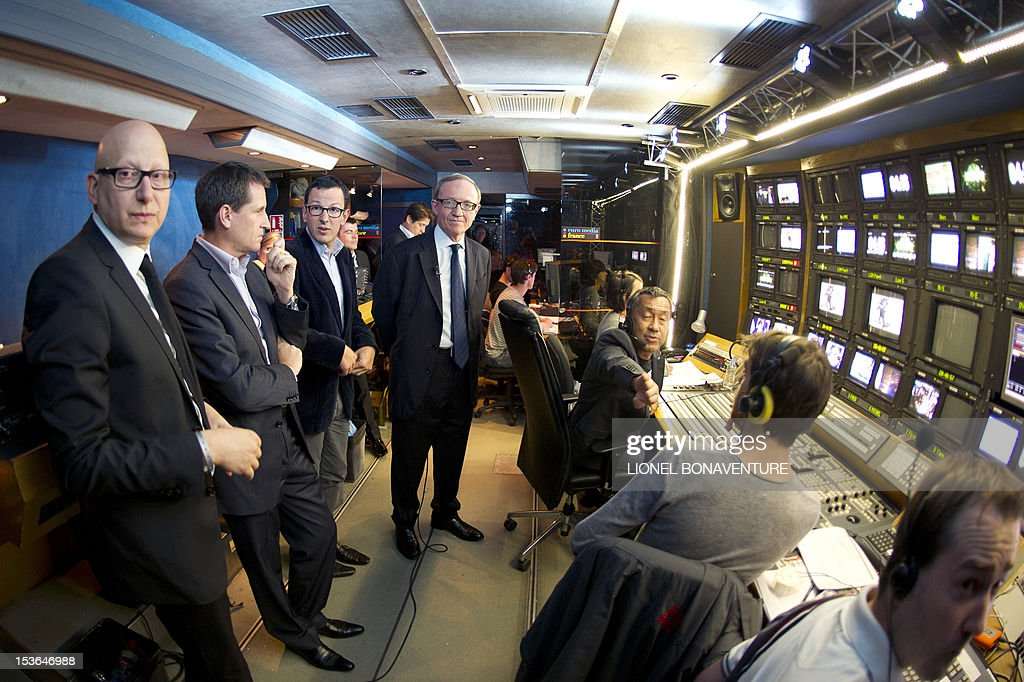 Canal+ flow unit manager Ara Aprikian (L), Canal+ deputy general director Rodolphe Belmer (2ndL) and Canal + CEO Bertrand Meheut (C) are seen prior to the official launch of the French D8 TV channel flanked by the hosts of the channel on October 7, 2012 in Paris. D8 is the new name of Direct 8 that Canal + group bought to French Bollore group. Bachelot will host the program 'Le Grand 8' with Hapsatou Sy and journalists Elisabeth Bost, Audrey Pulvar and Laurence Ferrari. AFP PHOTO LIONEL BONAVENTURE