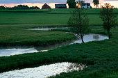 Canal flowing through farmland