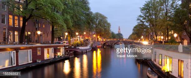 Canal houseboats at dusk, Amsterdam, The Netherlands