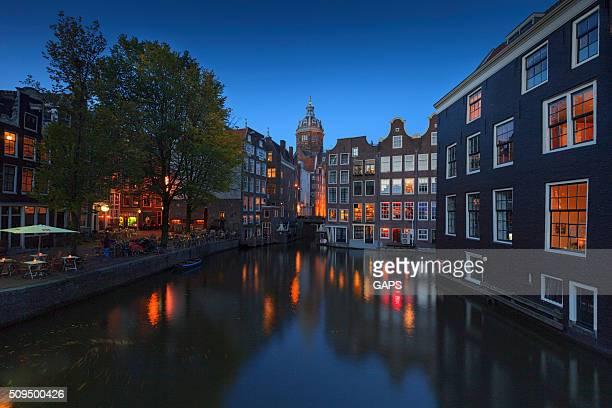 canal houses along Zeedijk in Amsterdam at dusk