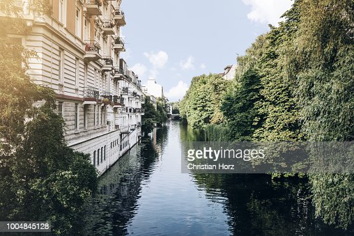 canal in residential neighborhood in Hamburg, Germany on sunny summer day : Stock Photo