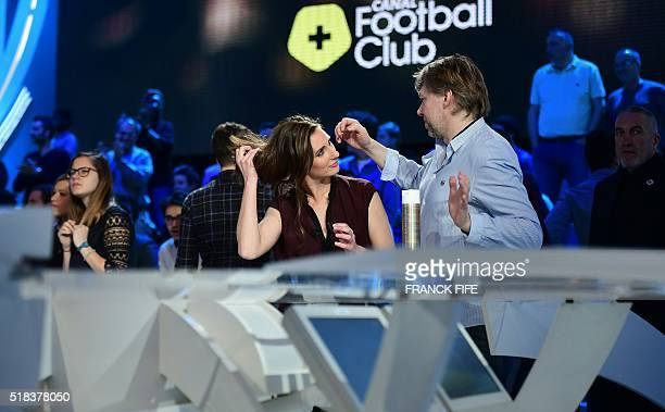 Canal Plus Journalist Marie Portolano gets ready prior to the start of the TV show 'Canal Football Club' on March 27 2016 in Paris / AFP / FRANCK FIFE