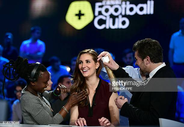 Canal Plus Journalist Marie Portolano jokes before the TV show 'Canal Football Club' on March 27 2016 in Paris / AFP / FRANCK FIFE