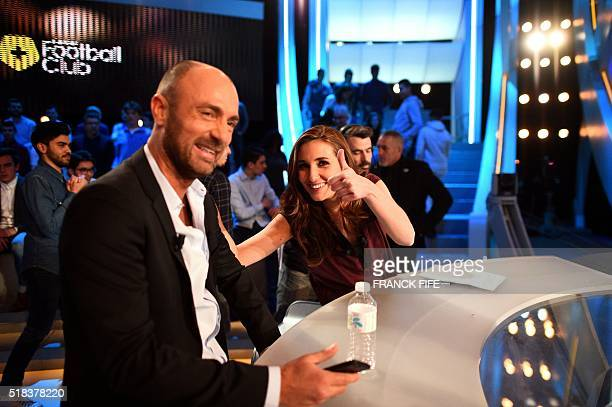 Canal Plus Journalist Marie Portolano jokes with former international football player turned sports consultant Christophe Dugarry before the TV show...