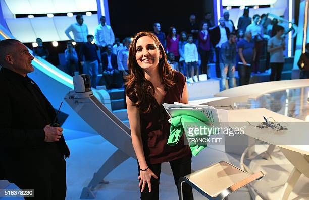 Canal Plus Journalist Marie Portolano leaves the TV show 'Canal Football Club' on March 27 2016 in Paris / AFP / FRANCK FIFE