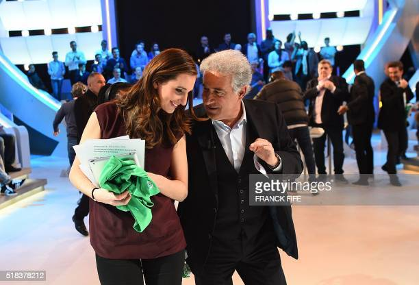 Canal Plus Journalist Marie Portolano speaks with SaintEtienne football club Copresident Bernard Caiazzo at the end of the TV show 'Canal Football...