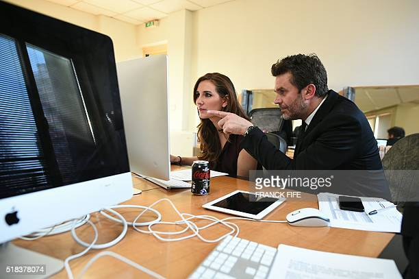 Canal Plus Journalist Marie Portolano speaks with sports journalist and tv show host Herve Mathoux prior to the start of the TV show 'Canal Football...