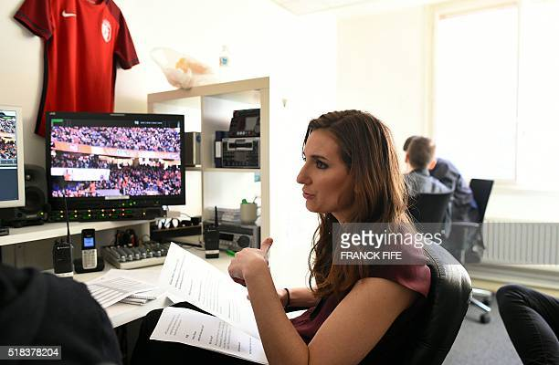 Canal Plus Journalist Marie Portolano works prior to the start of the TV show 'Canal Football Club' on March 27 2016 in Paris / AFP / FRANCK FIFE