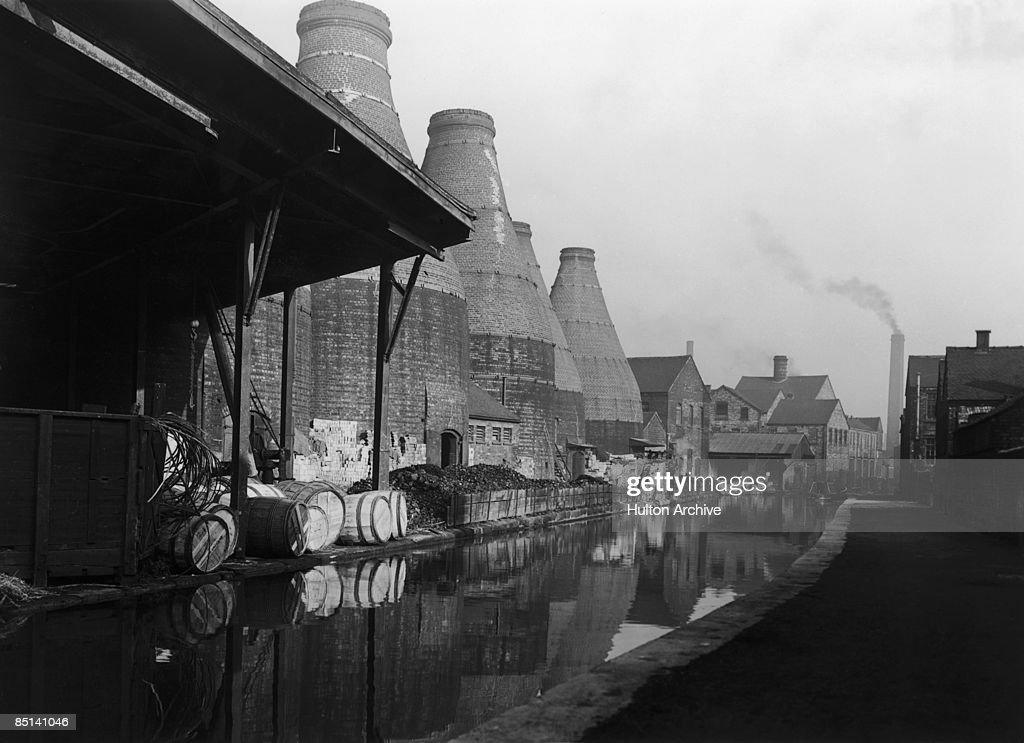 A canal running alongside bottle kilns belonging to potteries in StokeonTrent Staffordshire circa 1948