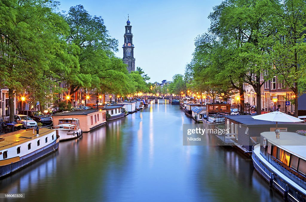 canal with house boats in Amsterdam