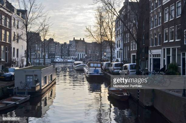 Canals in the old town center with boats and floating houses on both sides Amsterdam 7th December 2016