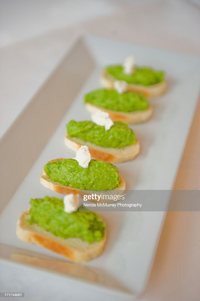 Canape pea puree on french bread stock photo getty images for Types of canape bases