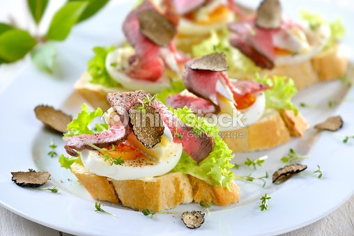 Canapes with roast beef and truffle stock photo thinkstock for Roast beef canape
