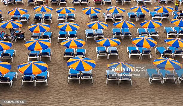 Canary Islands, Lanzarote, parasols and sunbeds on beach