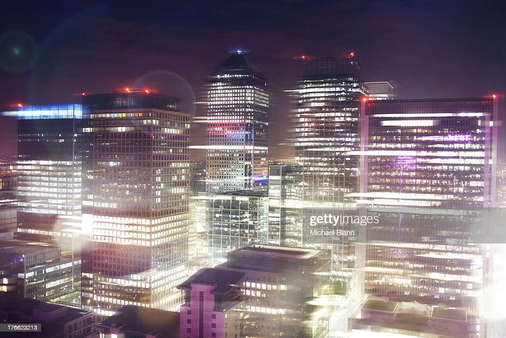 Canary Wharf at night with lights : Stock Photo