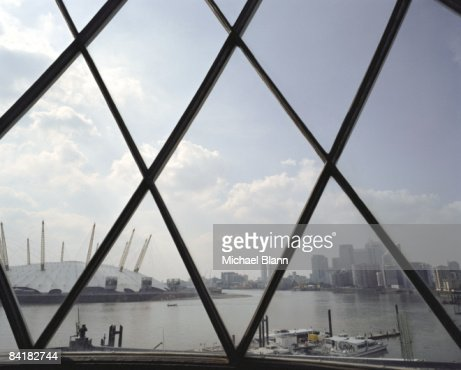 Canary wharf, millenium dome seen through window : Stock Photo