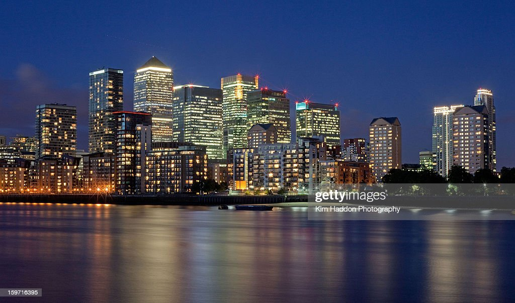 Canary Wharf skyline and river at Night : Stock Photo