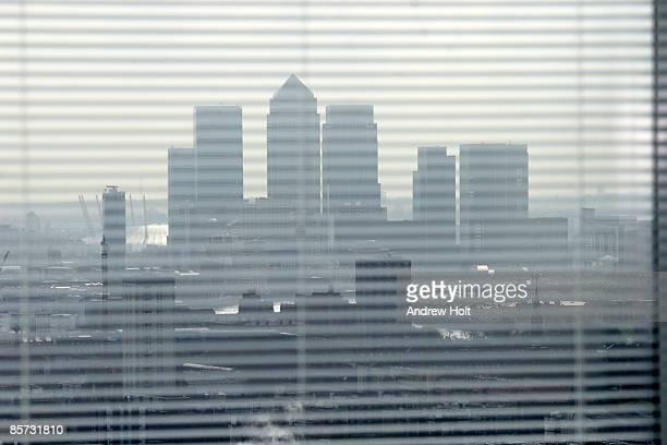 Canary Wharf skyline view through window blinds