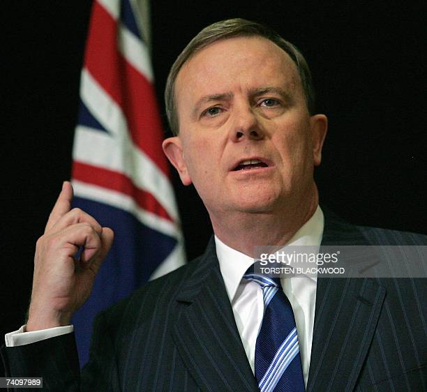 Australian Treasurer Peter Costello gestures as he announces generous tax cuts in the federal budget at Parliament House in Canberra 08 May 2007...