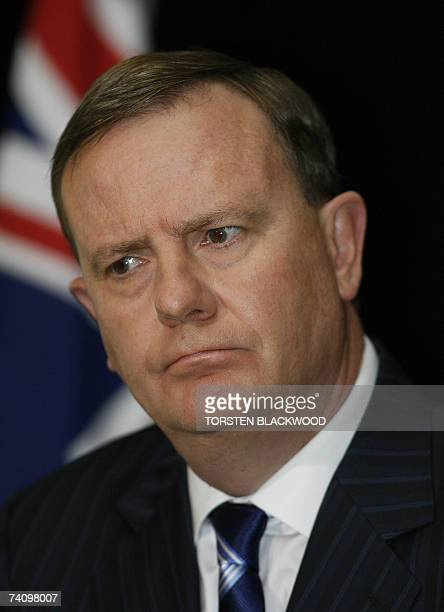 Australian Treasurer Peter Costello ponders a question from the media after announcing generous tax cuts in the federal budget at Parliament House in...