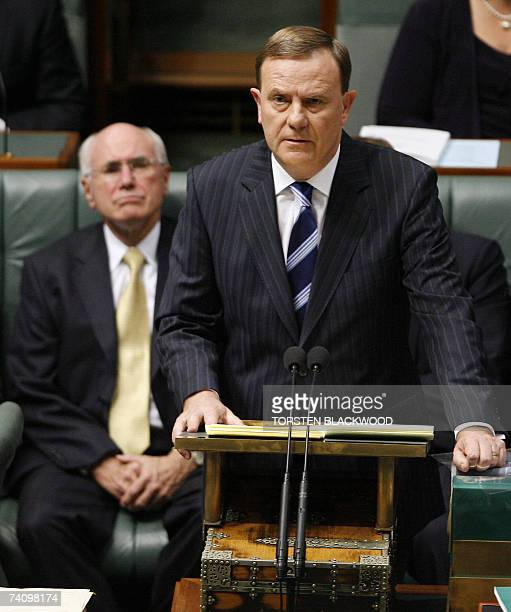 Treasurer Peter Costello delivers the federal budget as Australian Prime Minister John Howard looks on at Parliament House in Canberra 08 May 2007...