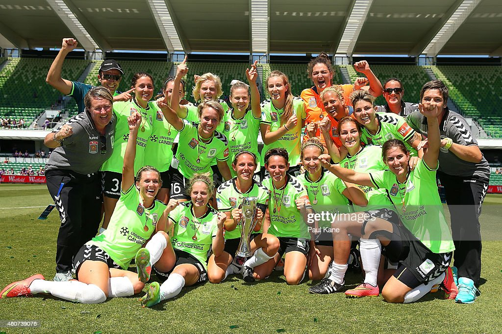 Canberra players and coaching support staff celebrate winning the W-League Grand Final match between Perth and Canberra at nib Stadium on December 21, 2014 in Perth, Australia.